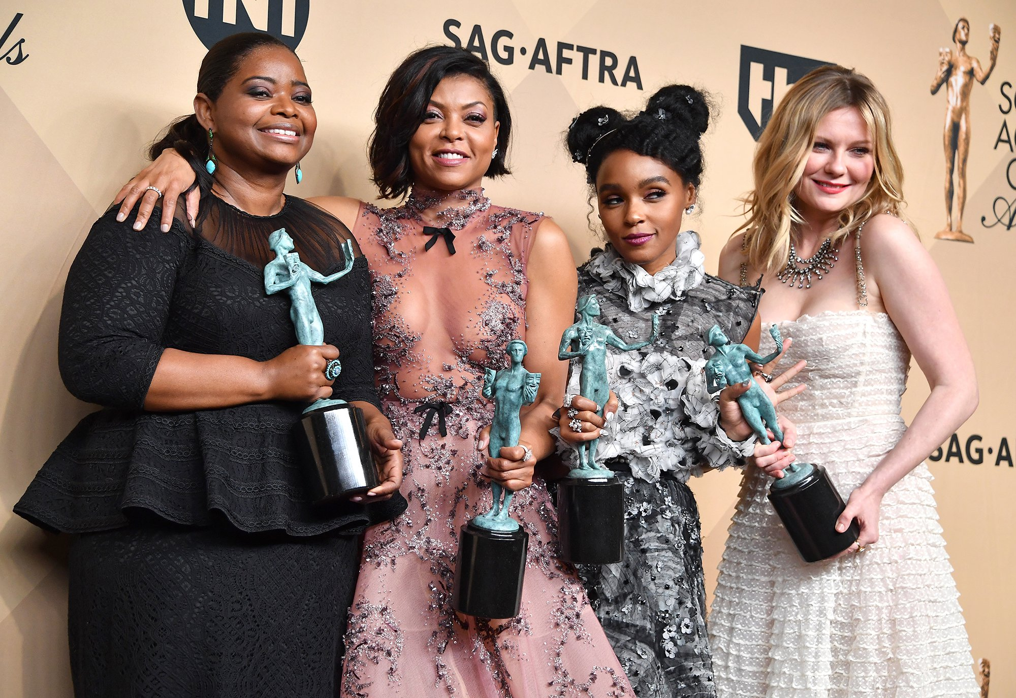 LOS ANGELES, CA - JANUARY 29:  (L-R) Actors Octavia Spencer, Taraji P. Henson, Janelle Monae and Kirsten Dunst, winners of the Outstanding Cast in a Motion Picture award for 'Hidden Figures,' poses in the press room during the 23rd Annual Screen Actors Guild Awards at The Shrine Expo Hall on January 29, 2017 in Los Angeles, California.  (Photo by Steve Granitz/WireImage)