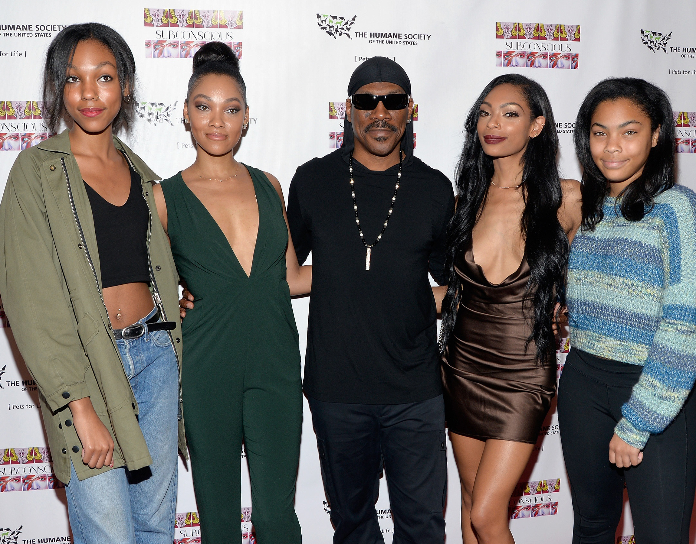 "LOS ANGELES, CA - NOVEMBER 20:  (L - R) Zola Murphy, artist Bria Murphy, actor Eddie Murphy, Shayne Murphy and Bella Murphy attend the debut gallery opening of Bria Murphy's ""Subconscious"" benefiting the Pets for Life Program for The Humane Society at Los Angeles Contemporary Exhibitions on November 20, 2016 in Los Angeles, California.  (Photo by Michael Tullberg/Getty Images)"